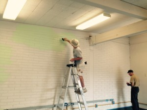 Ken painting Lockwood Elementary during Community Serve Day.